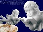 Aniołek leżący czytający książkę -alabaster